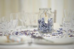 lilac_hydrangea_petals_as_table_decorations_