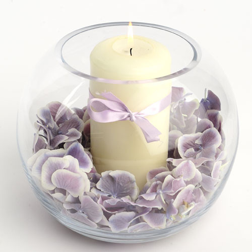 Wisteria- hydrangea petals in a fish bowl with church candle