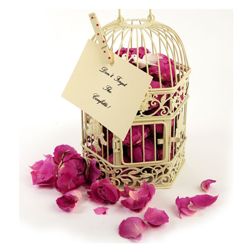 peony heads and petals- why not fill a birdcage with petals as a stunning centerpiece