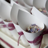 why not tie a pretty ribbon around your cones to match your colour scheme