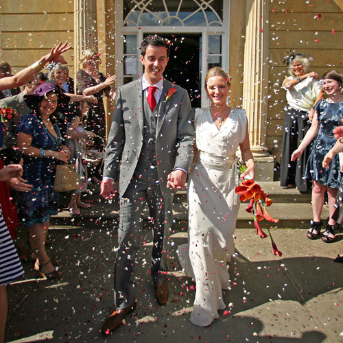 Tam & James Peake - a lovely red and white confetti photo
