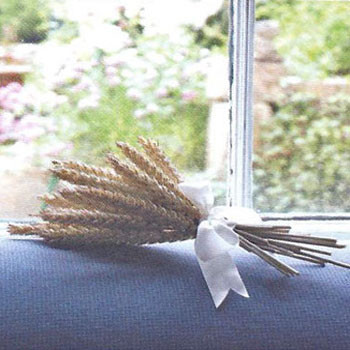 A wheat bundle on the window sill